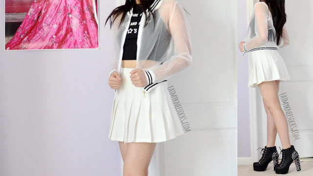 A monochromatic grunge-rock outfit featuring Dresslink's sheer striped bomber jacket and halter crop top, worn with a white pleated American Apparel tennis skirt and black spiked Jeffrey Campbell Lita platform booties.