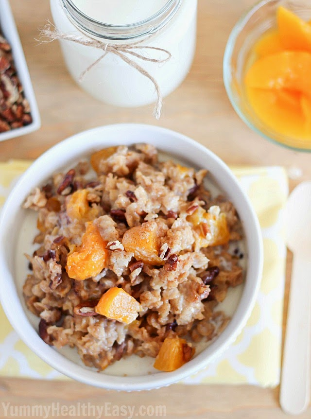 Start the day off with a healthy and EASY breakfast with this Slow Cooker Peach Oatmeal! AD