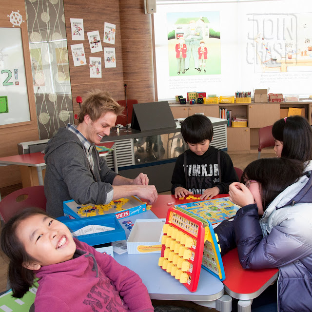 Playing board games with students during Winter English Camp at Bibong Elementary in Ochang.