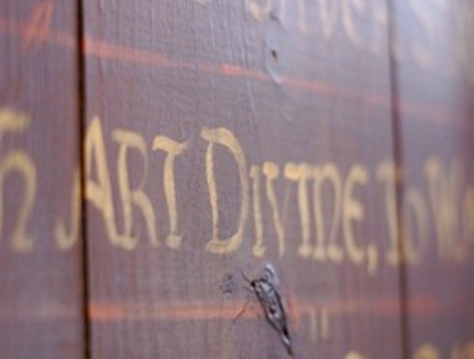 Close up of the hand painted text in the den