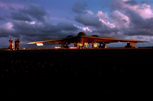 A B-2 Spirit bomber is prepared for a morning mission at Anderson Air Force Base, Guam.