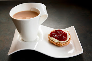 Cup of tea and a scone with jam and clotted cream