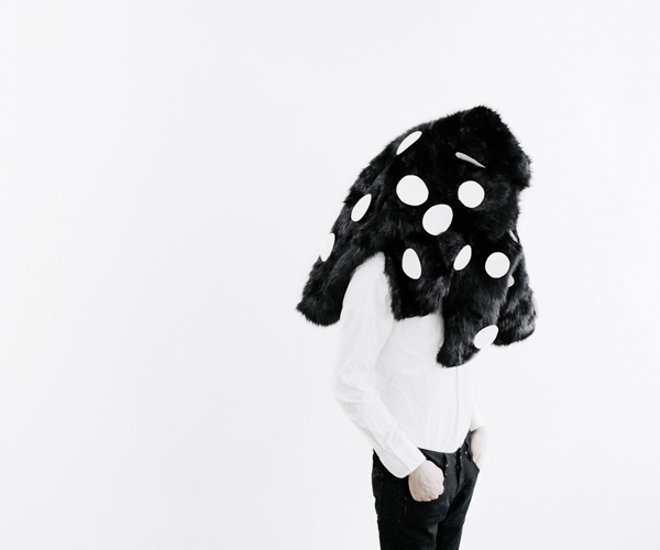 Black fur and white dots