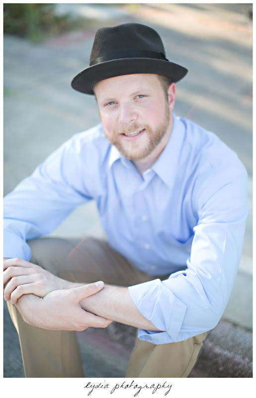 Groom with a hat on at lifestyle engagement portraits in the Bay Area of California