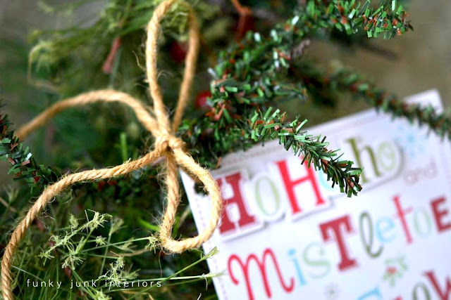 Make a Christmas card wreath with an old piece of garland. via Funky Junk Interiors
