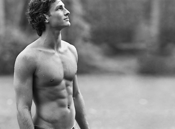 a younger Parker Gregory shirtless in black and white