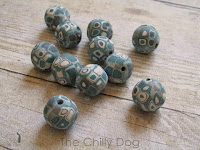 http://www.thechillydog.com/2015/08/clay-tutorial-applying-canes-to-beads.html