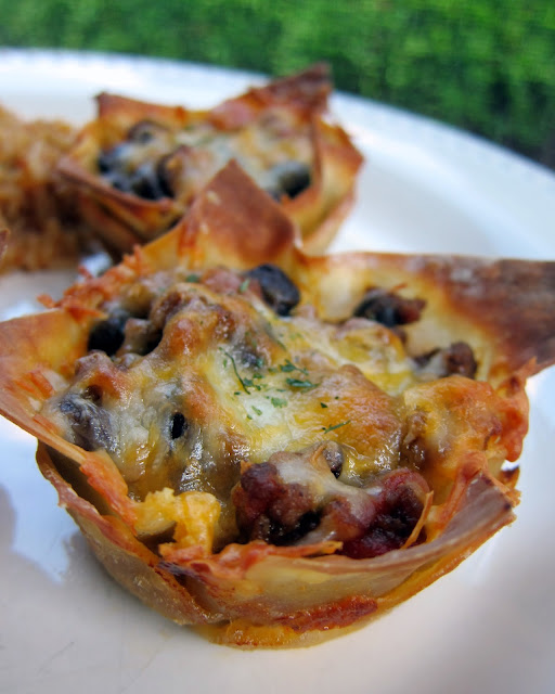Taco Cupcakes Recipe - the original recipe! Taco meat, black beans, and cheese baked in wonton wrappers in a muffin pan. Top with your favorite taco toppings. Kids (and adults) love these! Great for lunch, dinner or parties!!
