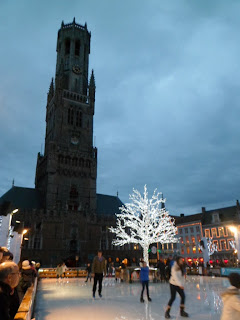 Belfry tower in Bruges, Belgium complete with Christmas ice rink
