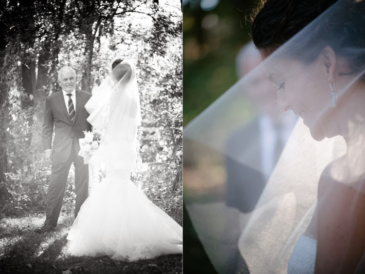 bride glancing at her dad in a black and white portrait