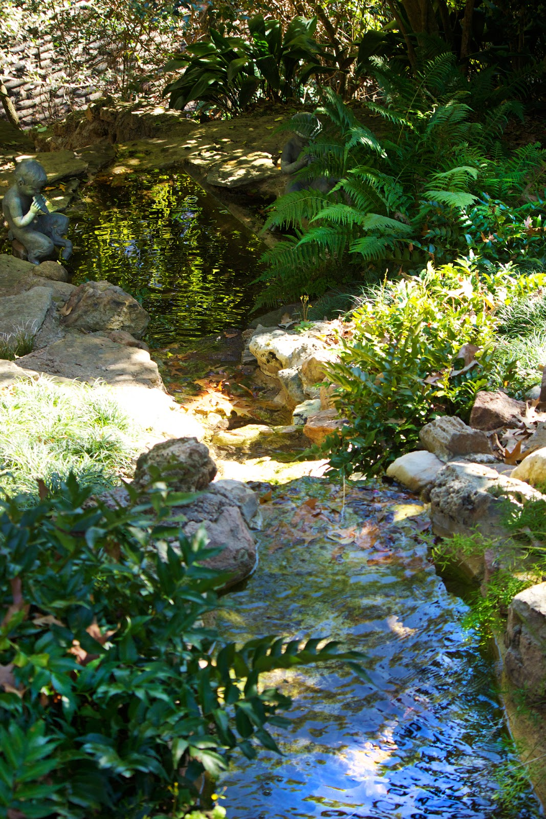 fairy river and stream with statues - photo copyright Allison Beth Cooling