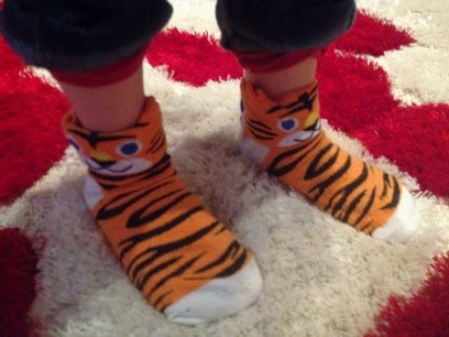 http://www.oasap.com/tights-socks/44079-tiger-print-crew-socks.html