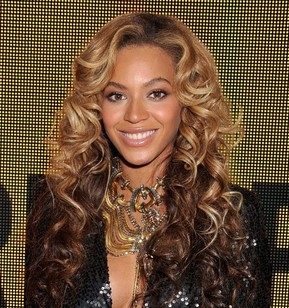Fashionista and singer Beyonce glamorous style outfits blonde ombre defined curls.