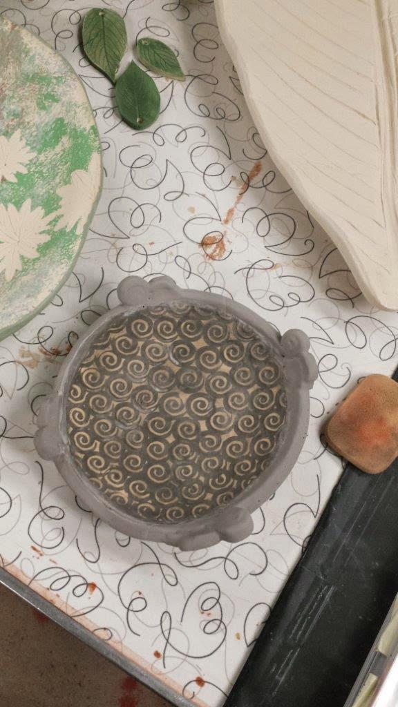 Unique swirly handmade ceramic pottery stoneware bowl in progress.