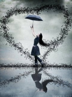 girl with umbrella in heart enjoying rain
