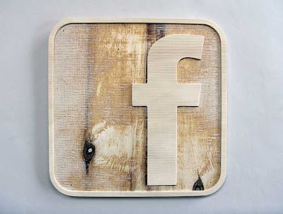 Facebook F logo rendered in 3D from routered wood