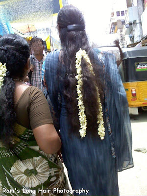 Freshly washed long hair decorated with jasmine flowers.