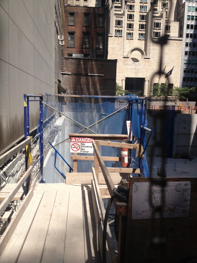 Photo of worker staircase into the site