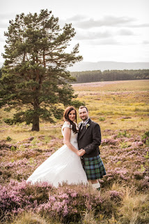 the newly weds pose in the beautiful Scottish landscape