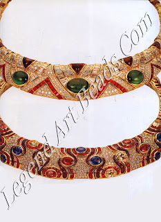 """A necklace of yellow gold, set with round and baguette diamonds, baguette rubies, triangular cabochon amethysts and five large cabochon emeralds. Below it, a diamond """"carpet"""" necklace set with forty fancy oval-cut sapphires amid sinuous ruby and amethyst motifs."""