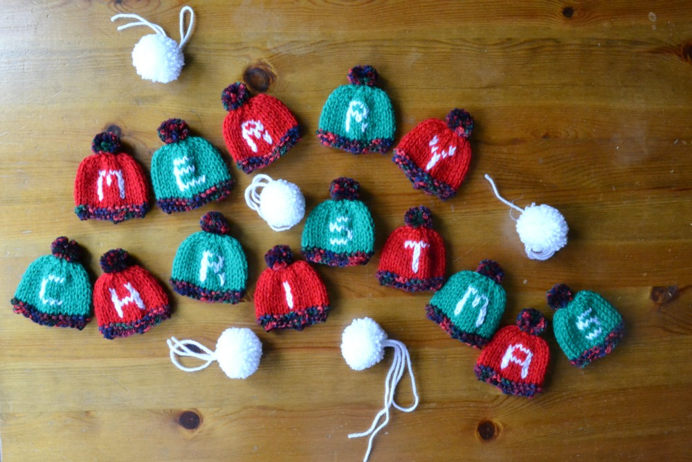 tiny knitted bunting letter bobble hats christmas pompoms