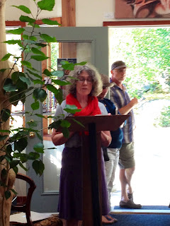Poet Ellen McGinn, reading at Saturna Art Show, Insight Gallery
