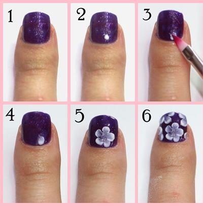 Paso 1 Aplicamos esmalte morado satinado en todas las uñas.