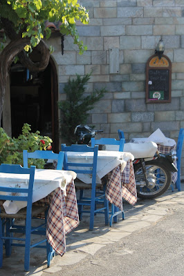 tables outside a traditional Greek taverna