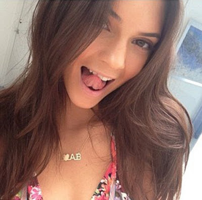 Kendall Jenner showing off her initial necklace