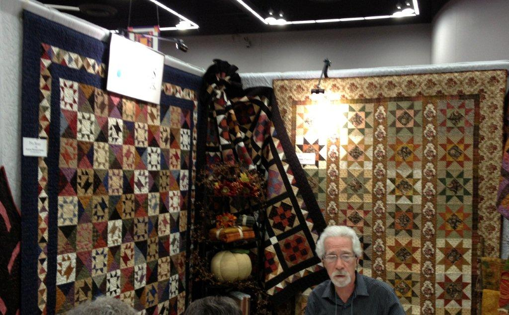 Humble quilts favorite booths at quilt market for Tending the garden blackbird designs