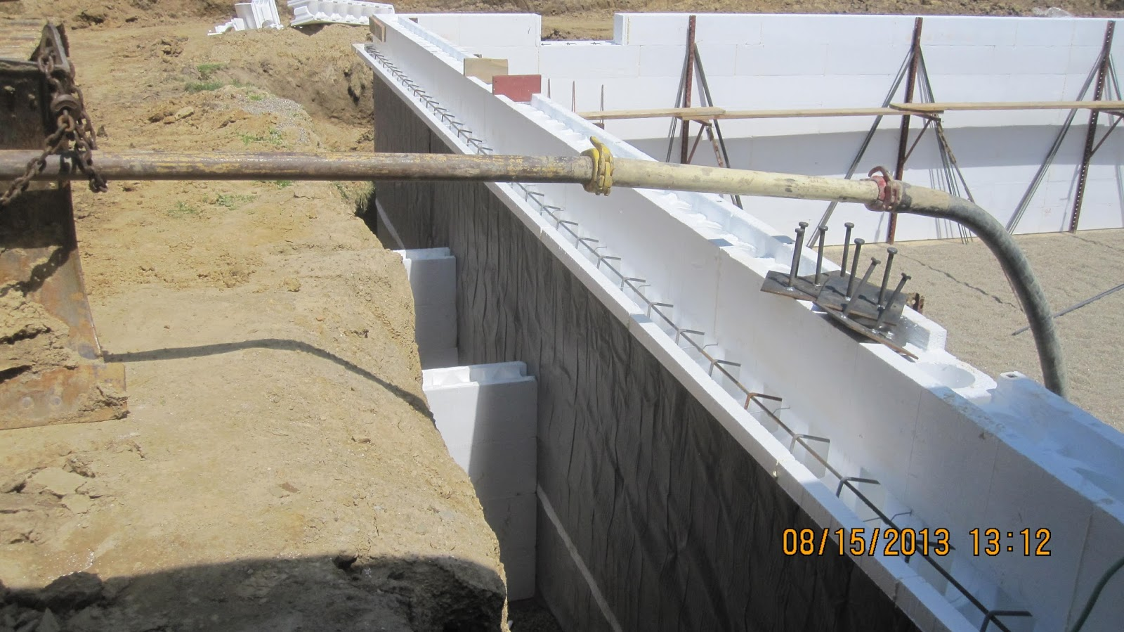Energy efficient building network placing concrete in for Icf basement construction
