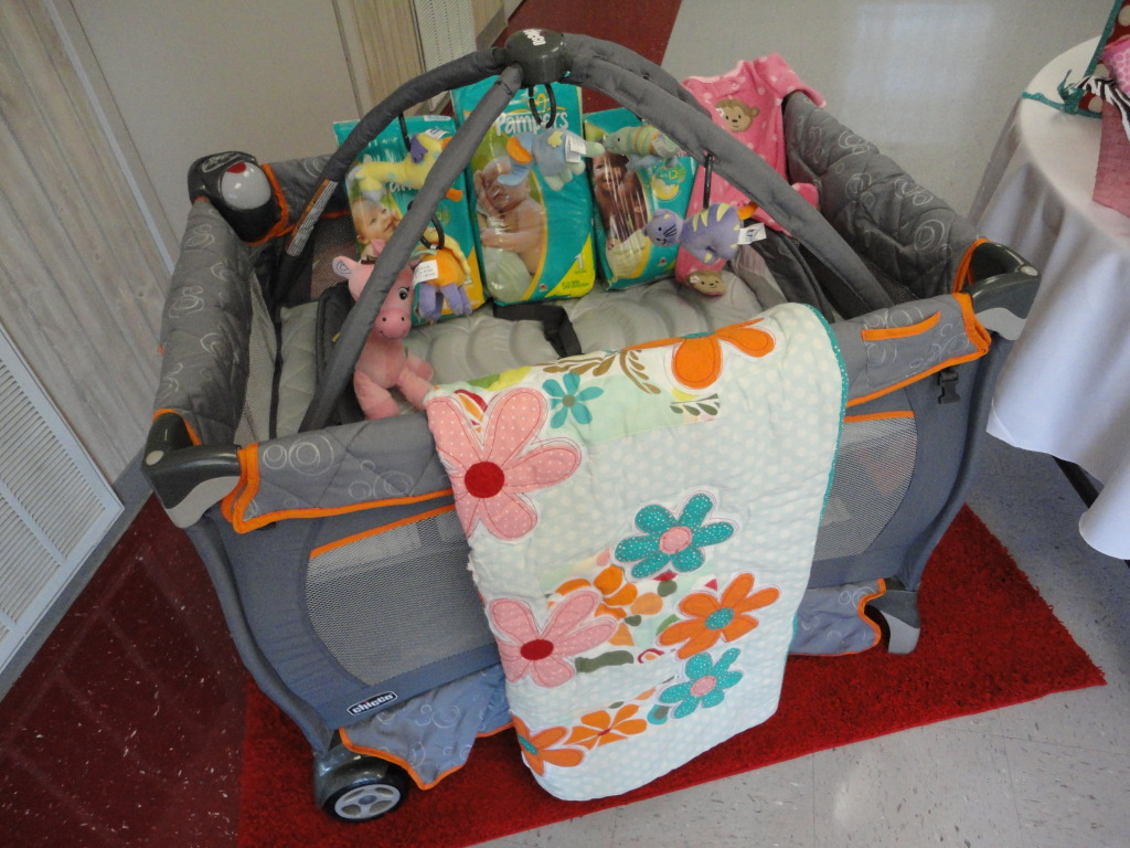 This Was The Hostess Gift. You Can See Her Baby Bedding Draped Over The  Side. The Showeru0027s Entire Color Scheme Is Based On Her Colorful Bedding!