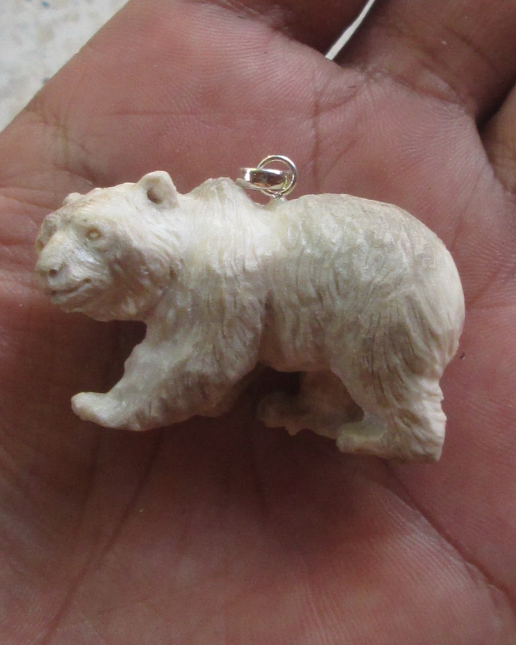 Carved Bear Bone Pendants in Antler
