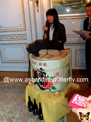Translator in front of ceremonial drum, Sake + Urushi of Northern Japan, 2013 Ninohe City Fair in New York City