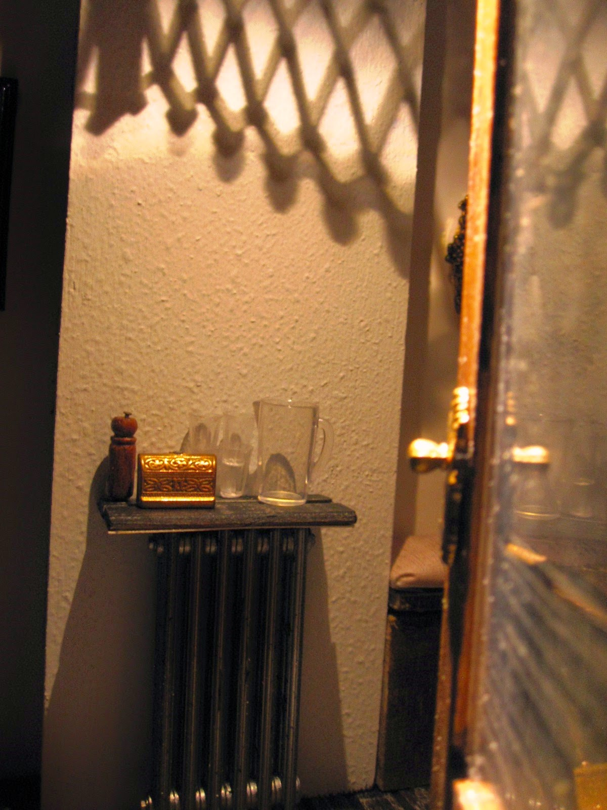 Interior of a modern dolls' house miniature cafe at night.