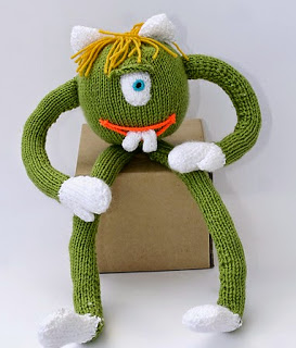 http://www.ravelry.com/patterns/library/monstrik-the-alien---toy-knitting-pattern