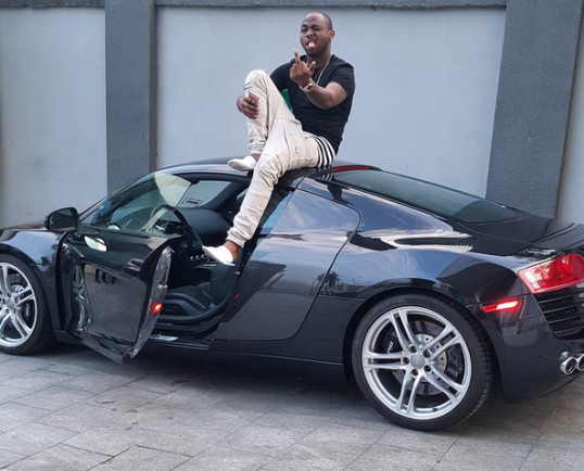 Baller Of Life!! Davido Sits On Top Of His Audi R8 Supercar Worth N30million (Photo)