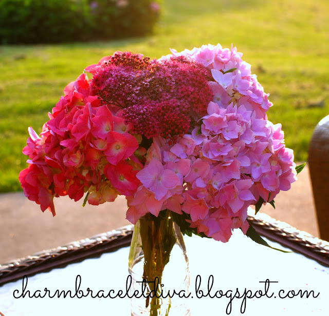 pink hydrangeas in vintage milk bottle