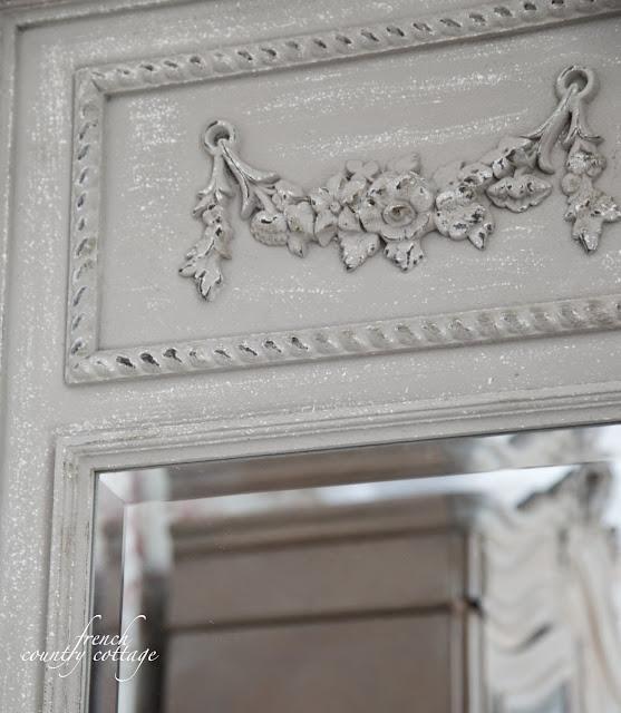 Close up of gray mirror in bathroom
