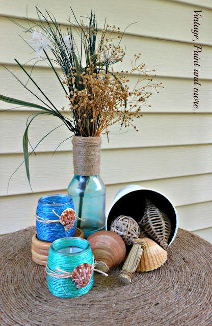 Vintage, Paint and more... raffia wrapped votive jars in a beach inspired vignette with a faux beach glass painted bottle and shells on a twine wrapped table