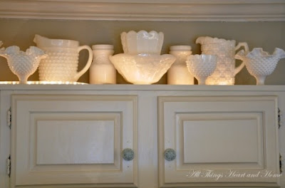 mylittlehousedesign.com uplight milk glass on top of kitchen cabinets