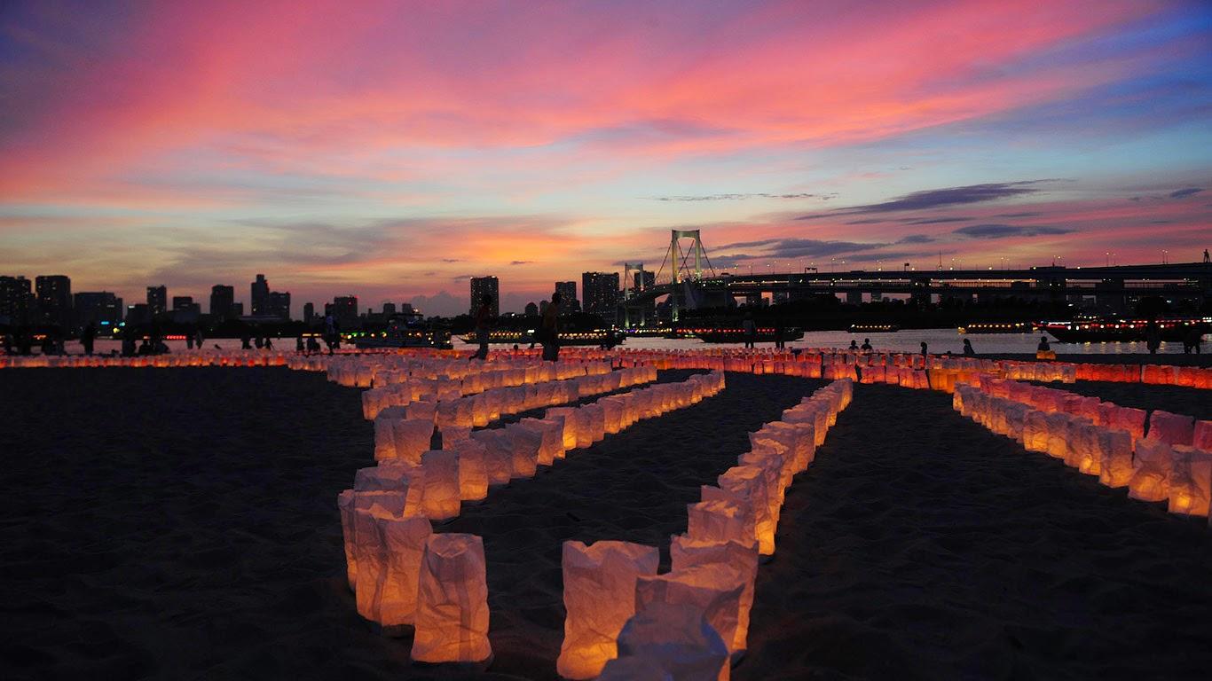 Candles line the beach at Odaiba Marine Park for Marine Day, Tokyo, Japan (© KeystoneUSA-ZUMA/Rex Features) 145