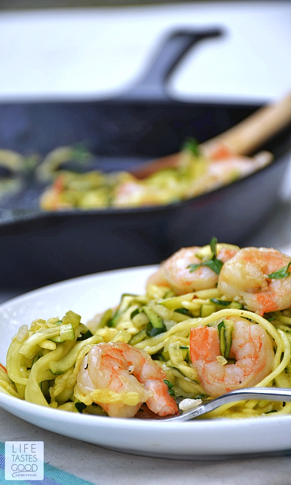 Shrimp Scampi Zoodles | by Life Tastes Good is a lower carb version of a traditional Shrimp Scampi recipe typically served over pasta. This recipe still has all the fresh tasting garlic and buttery goodness of the traditional recipe, but is served over zucchini noodles, or the more fun way of saying it 'zoodles', to get rid of all those carbs from the pasta. Just for the record... I didn't miss the pasta at all!