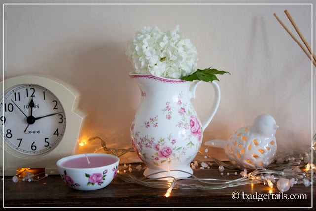snowball shrub white flower cutting in floral jug on mantle