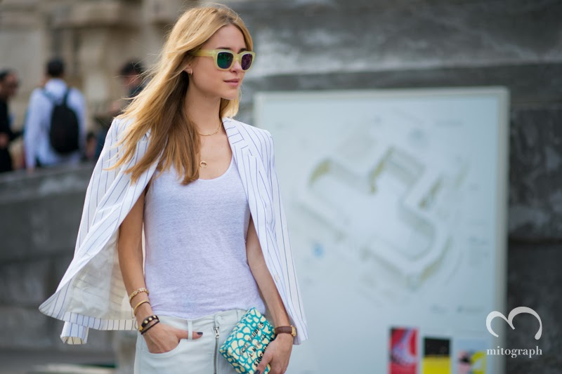 Blogger Pernille Teisbaek wears Acne Jacket Sunglasses Clutch Bag Pants at Paris Fashion Week
