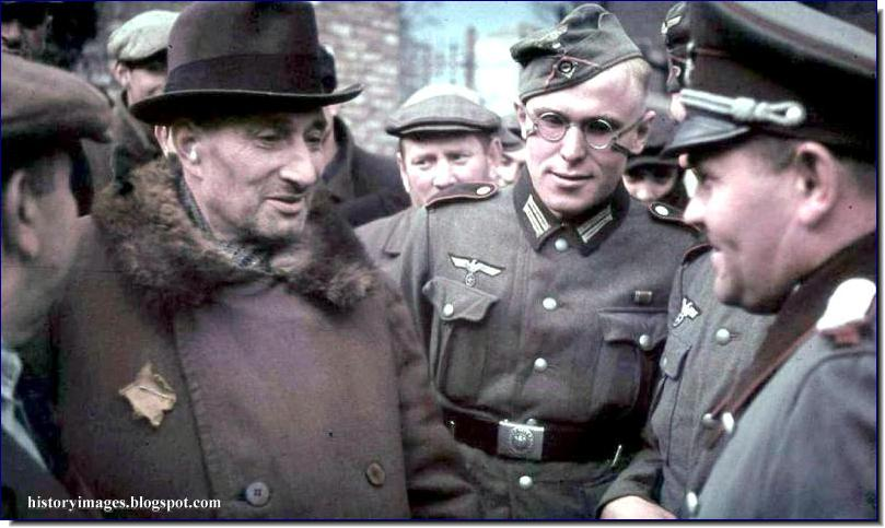 Paris. 1942. german soldiers talk to a jew. jews were supposed to wear