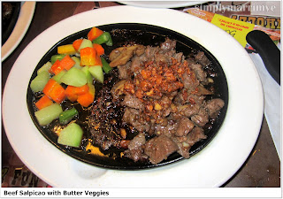 Tender beef cubes with lots of sauteed minced garlic and flavored sauce with buttered veggies on the side