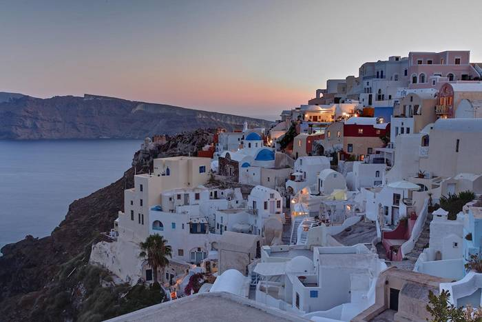 If you're going to visit only one Greek island in your life then let it be Santorini. Breathtaking volcanic views and one of the best sunsets in the world consistently place it at the top of any Greek islands list. Its beaches are very peculiar (and do not appeal to everyone) due to the black and red volcanic sand. Couples should opt for tranquil and romantic Oia, where luxury rooms with a Caldera (the volcanic crater) view can cost a forune, whereas those young at heart should choose Fira, the lively capital of the island built on top of the Caldera cliff with equally fantastic views. The eastern side of the island is generally cheaper and has little of the magic Santorini feel.