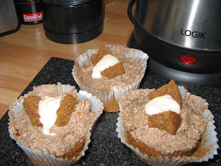 Coffee cupckes with a coffee cream and banana icing centre.