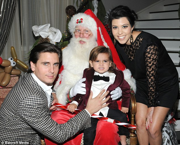 mason looked annoyed as his father held him on father christmas lap - Candy Christmas Divorce